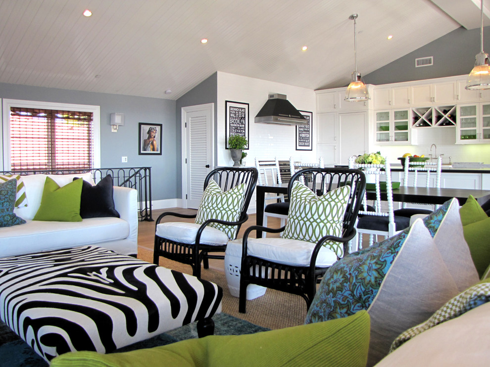 Example of a beach style living room design in Orange County with gray walls