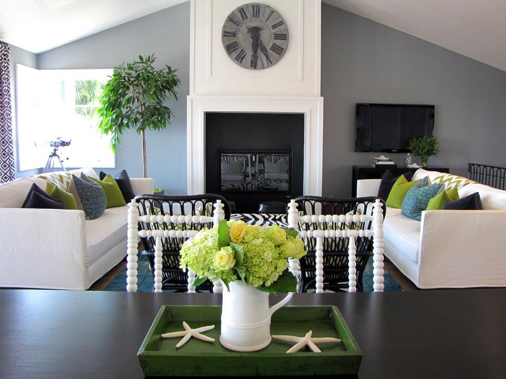 Coastal living room photo in Orange County with gray walls