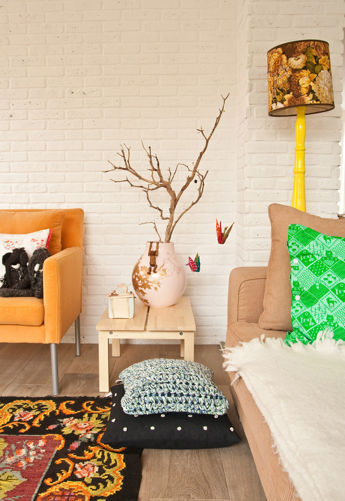 Living room - eclectic living room idea in Amsterdam with white walls