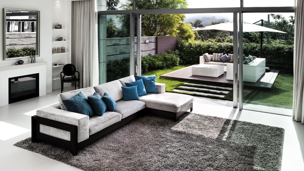 Living room - contemporary open concept living room idea in Hong Kong with white walls and a standard fireplace