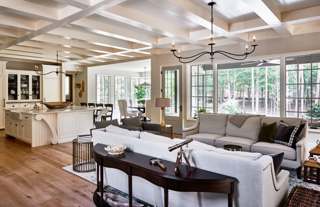 Example of a mid-sized classic open concept light wood floor living room design in Charlotte with beige walls and a standard fireplace