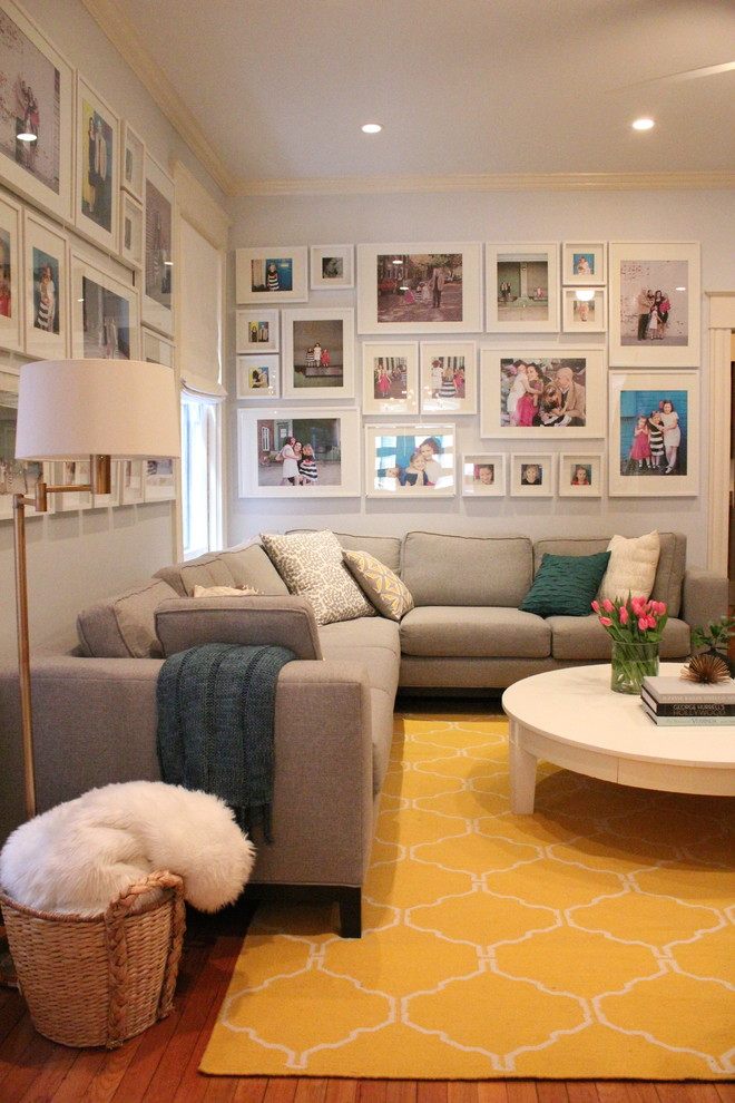 Living room - transitional medium tone wood floor living room idea in Richmond with gray walls