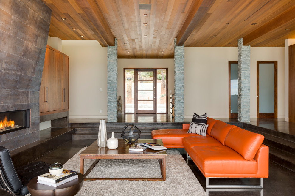Trendy open concept concrete floor living room photo in San Francisco with beige walls, a ribbon fireplace and a tile fireplace