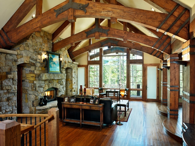 Timber frame home rustic living room by sitka log homes for Rustic timber frame house plans