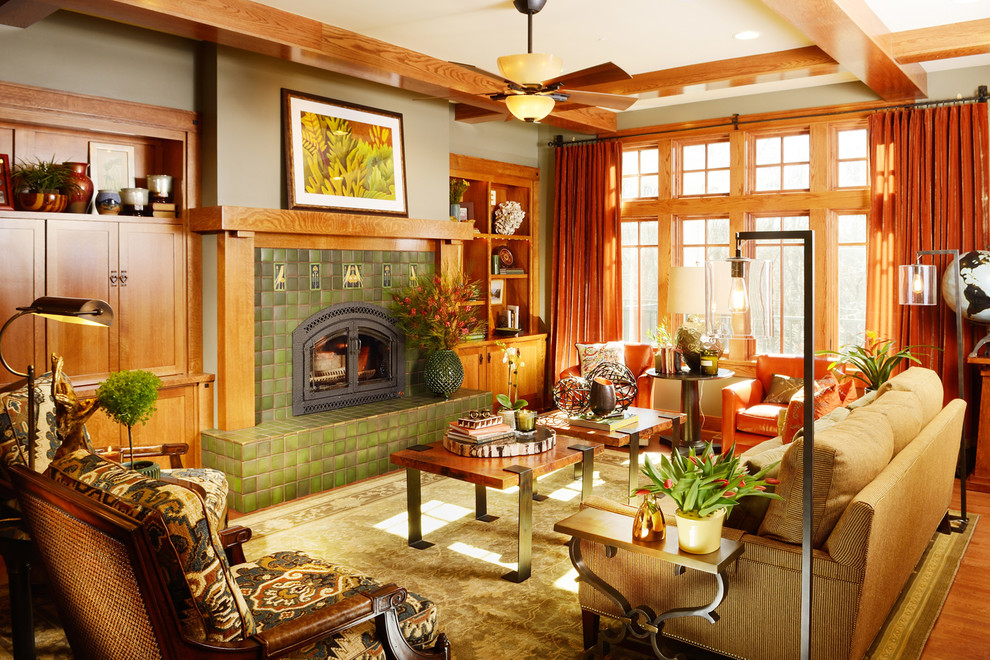 Example of a large arts and crafts open concept light wood floor living room design in Other with a standard fireplace, a tile fireplace, no tv and green walls
