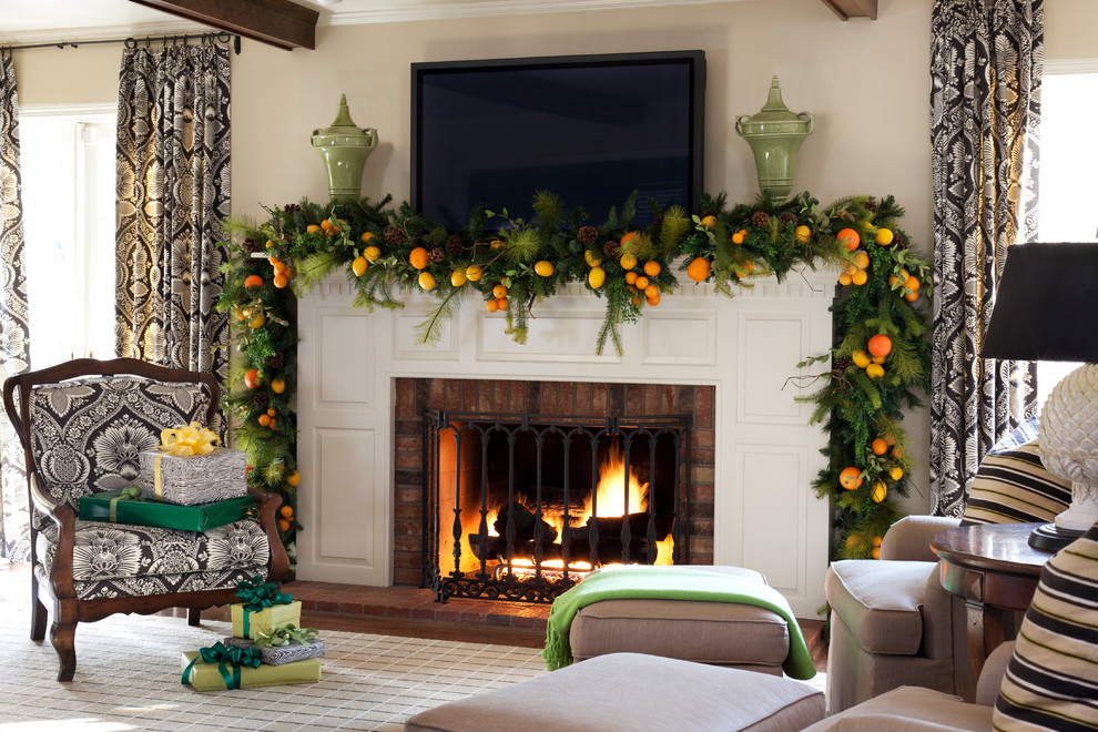 Example of a classic living room design in Little Rock with beige walls and a standard fireplace