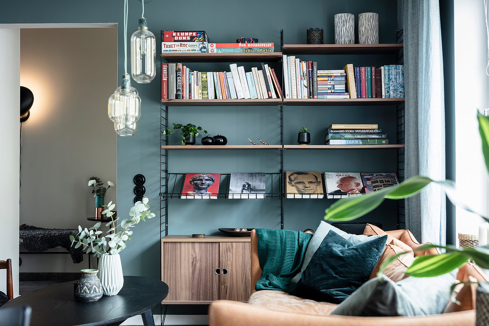 Inspiration for a large scandinavian open concept dark wood floor and brown floor living room remodel in Gothenburg with blue walls and a wall-mounted tv