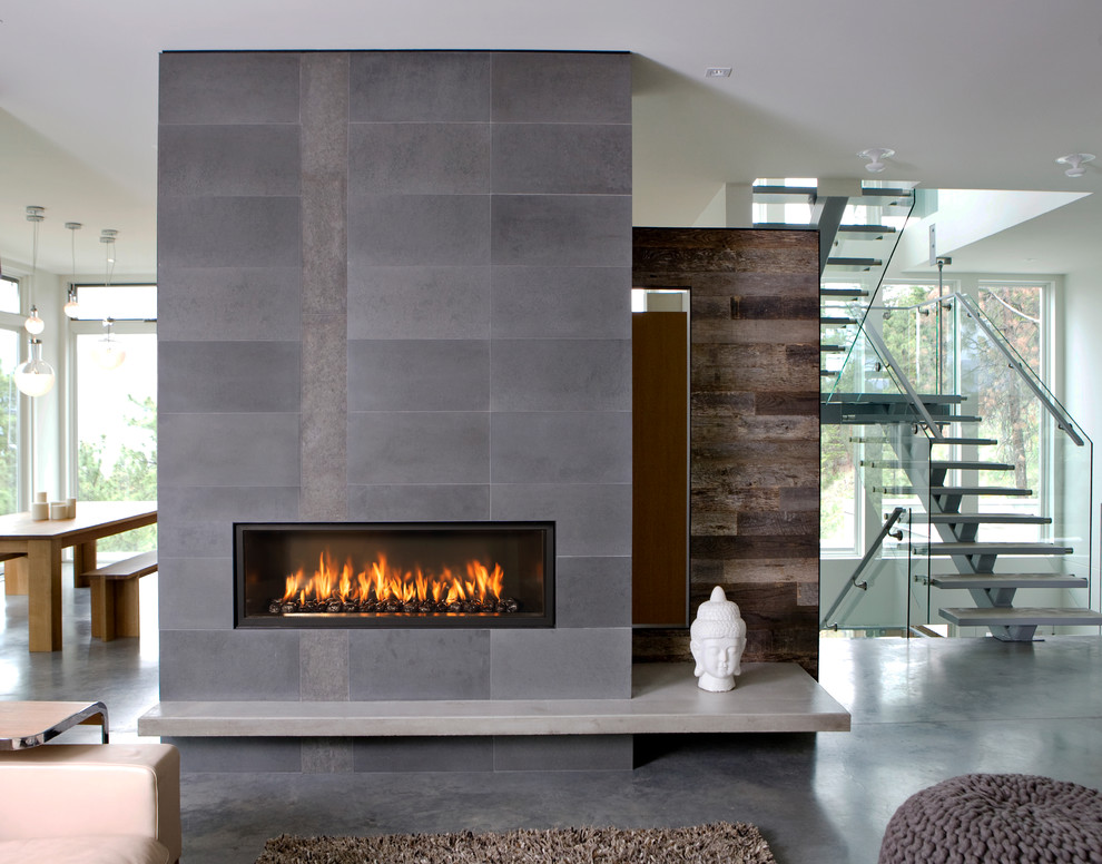 Trendy open concept concrete floor living room photo in Sacramento with a ribbon fireplace