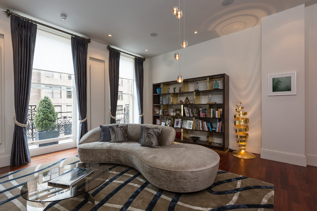 Inspiration for a contemporary formal living room in London with white walls and medium hardwood flooring.