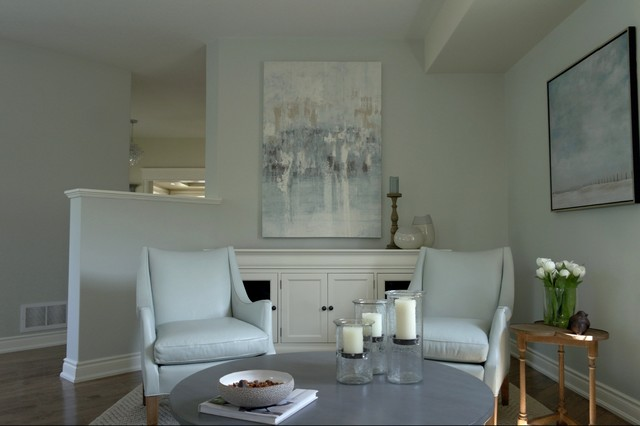 Design ideas for a small traditional formal open concept living room in Toronto with blue walls, dark hardwood floors, no tv and brown floor.