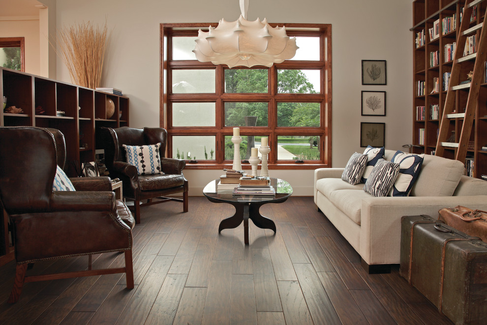 Mid-sized elegant enclosed dark wood floor living room library photo in Jacksonville with beige walls and no tv