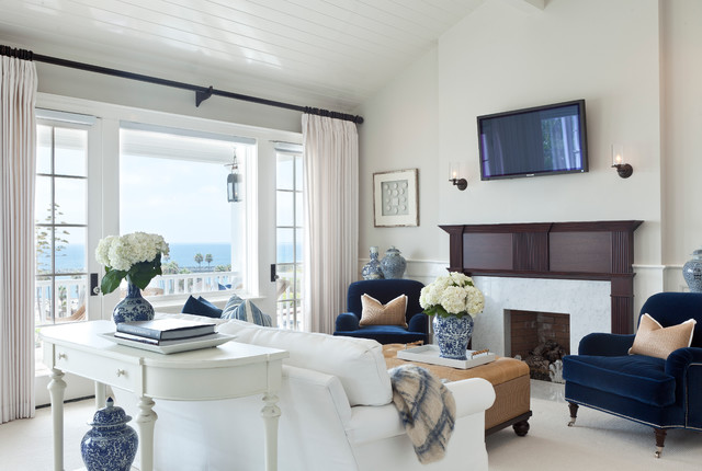 Design ideas for a medium sized nautical formal open plan living room in Los Angeles with grey walls, carpet, a standard fireplace, a wooden fireplace surround and a wall mounted tv.
