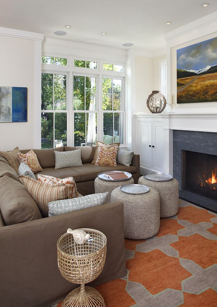 Living room - traditional multicolored floor living room idea in San Francisco with beige walls and a standard fireplace