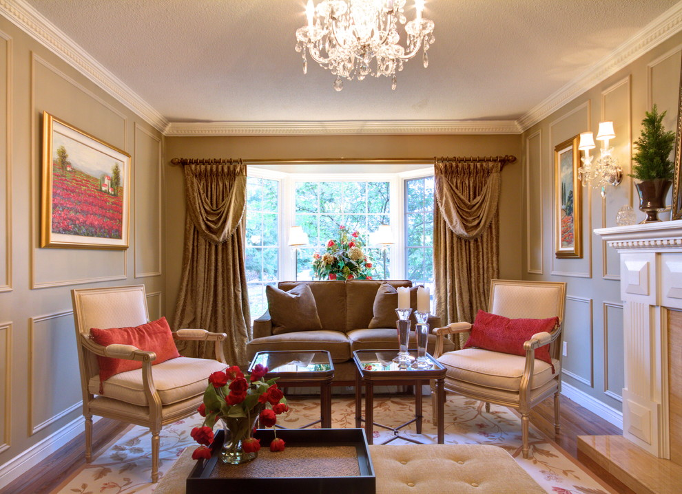 Inspiration for a timeless enclosed living room remodel in Toronto with beige walls and a standard fireplace
