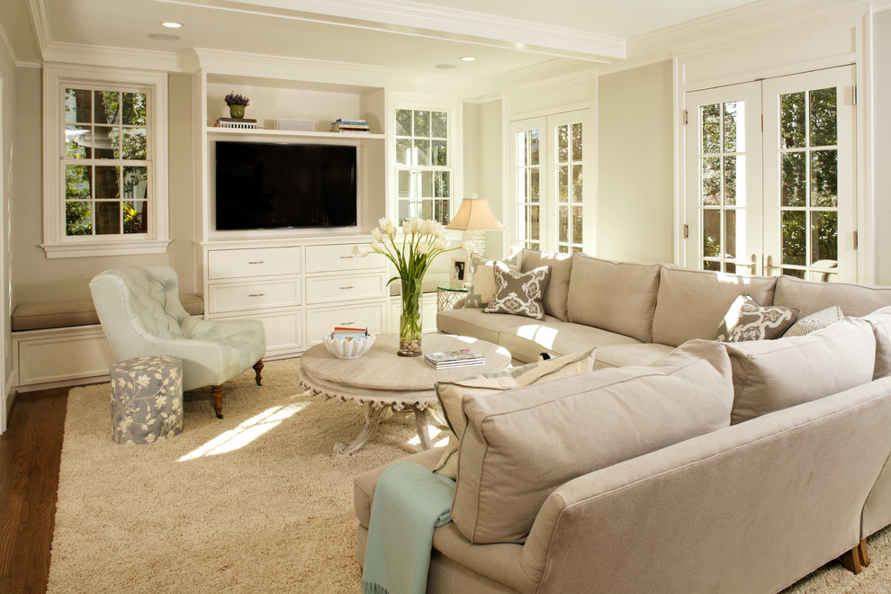Example of a mid-sized classic living room design in DC Metro with a wall-mounted tv
