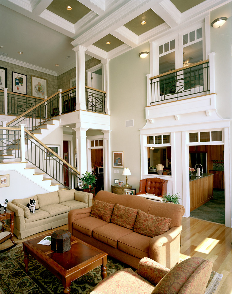 Example of a large classic living room design in Cincinnati with green walls