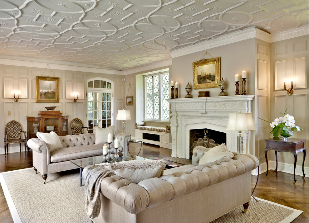 Example of a huge classic living room design in New York with beige walls