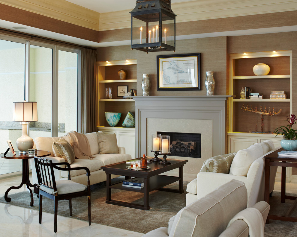 Example of a mid-sized classic open concept beige floor and marble floor living room design in Miami with a standard fireplace, no tv and a stone fireplace