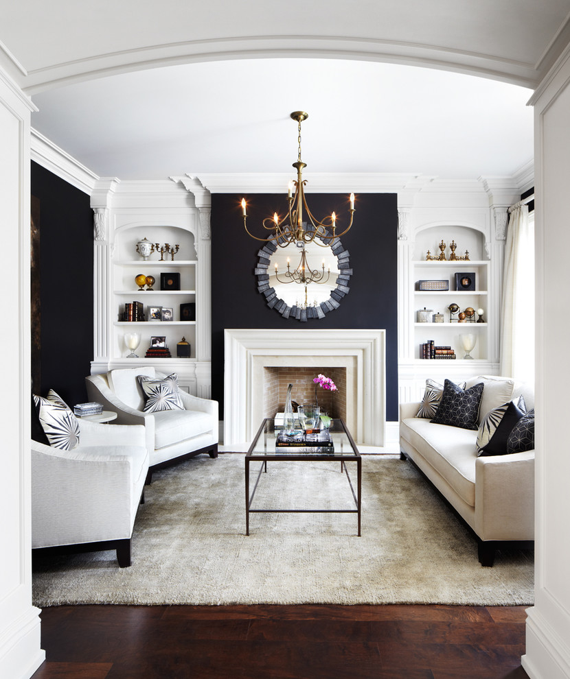Elegant formal and enclosed dark wood floor living room photo in Dallas with black walls, a standard fireplace and no tv