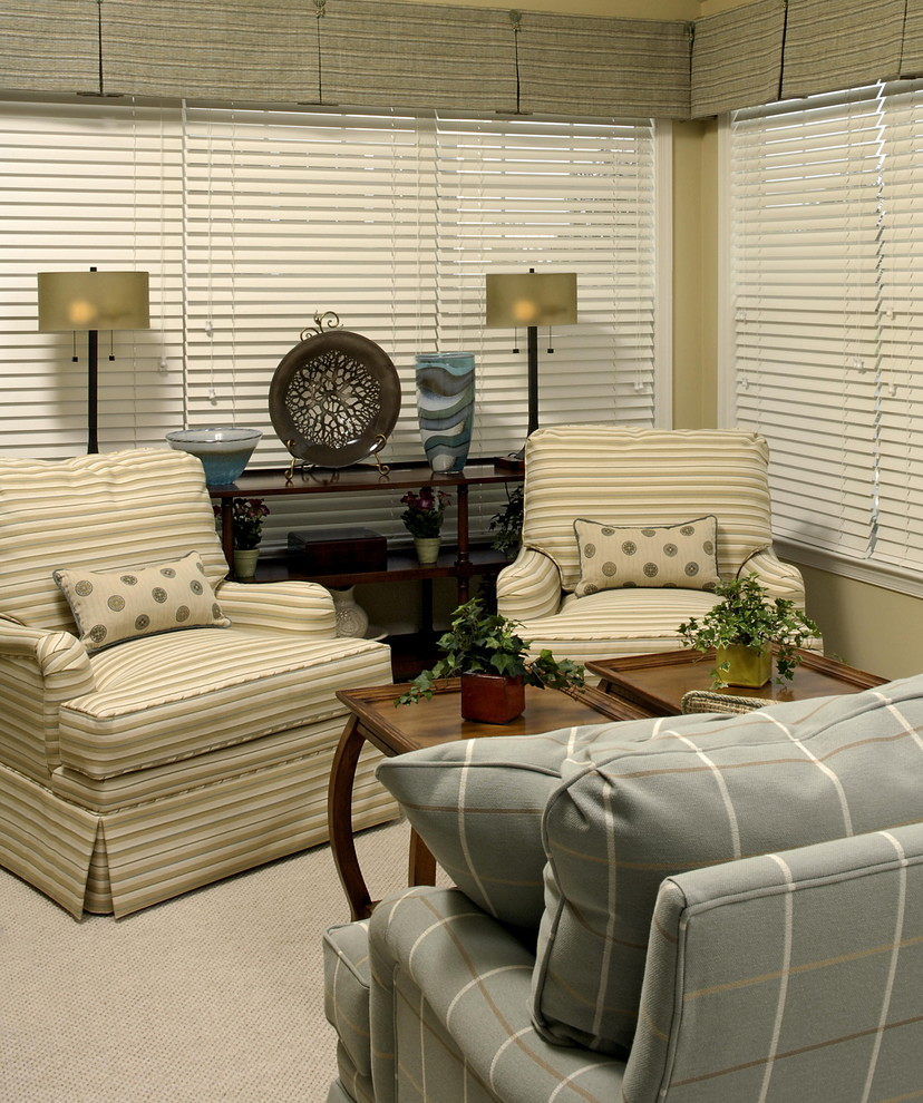 Example of a small classic living room design in DC Metro with beige walls