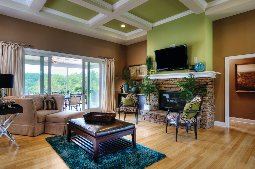 Living room - traditional living room idea in Cleveland with a stone fireplace