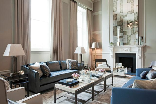 Esempio di un soggiorno classico con pareti grigie e camino classico