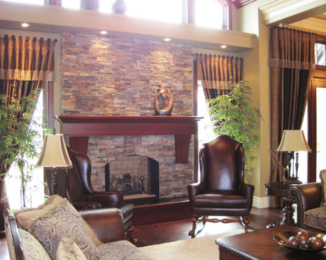 Traditional open concept stone fireplace traditional for Traditional open concept kitchen living room photos