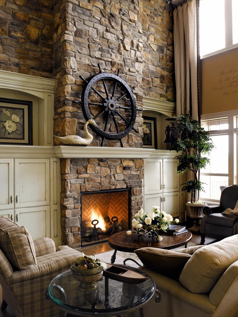 Living room - beach style living room idea in San Diego with beige walls, a standard fireplace, a stone fireplace and no tv
