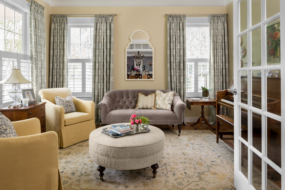 Inspiration for a mid-sized timeless enclosed and formal dark wood floor living room remodel in DC Metro with yellow walls, no fireplace and no tv