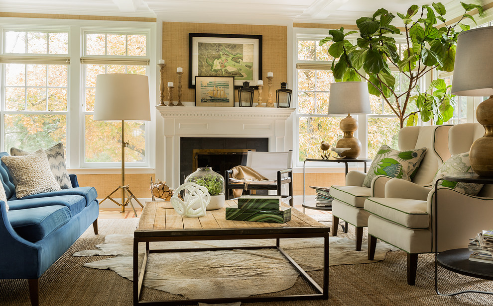 Example of a transitional formal living room design in Boston with beige walls and a standard fireplace