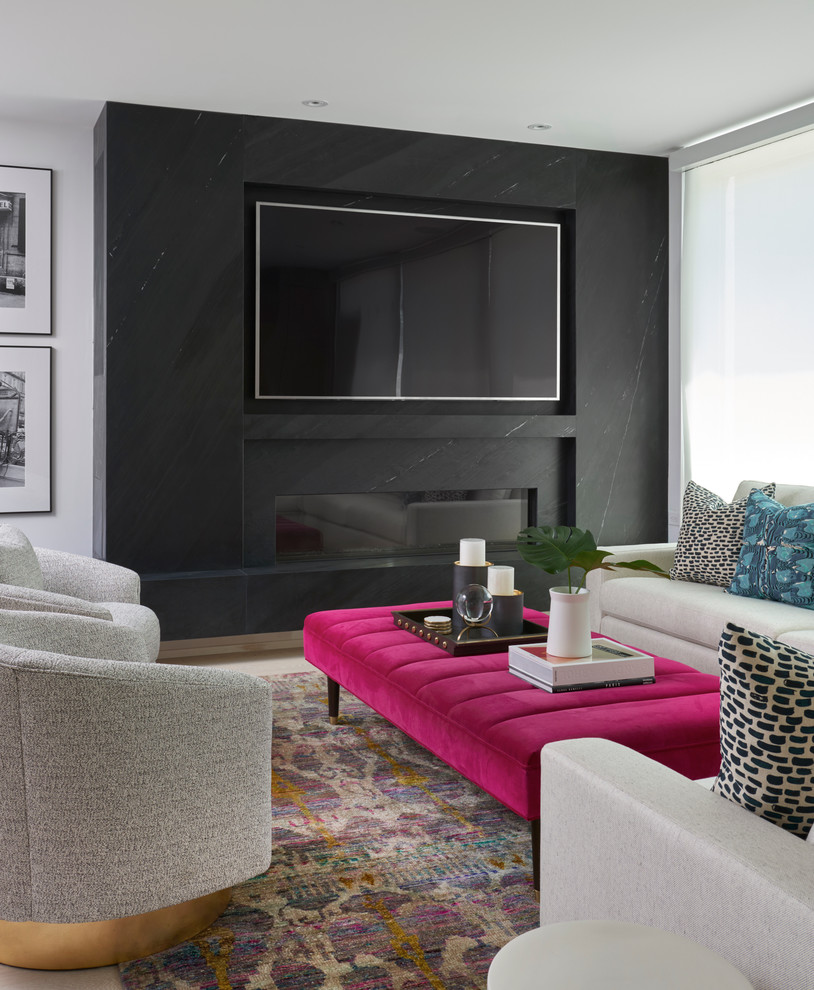 Inspiration for a transitional living room remodel in Toronto with black walls, a ribbon fireplace, a stone fireplace and a wall-mounted tv