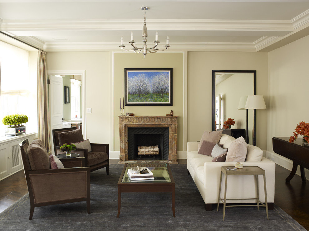 Example of a mid-sized classic dark wood floor and brown floor living room design in New York with beige walls, a standard fireplace and a stone fireplace
