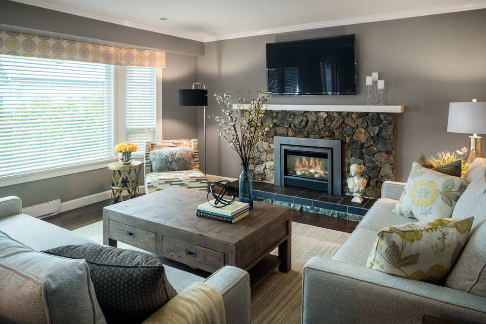 Mid-sized transitional formal and enclosed dark wood floor and brown floor living room photo in Vancouver with gray walls, a standard fireplace, a stone fireplace and a wall-mounted tv