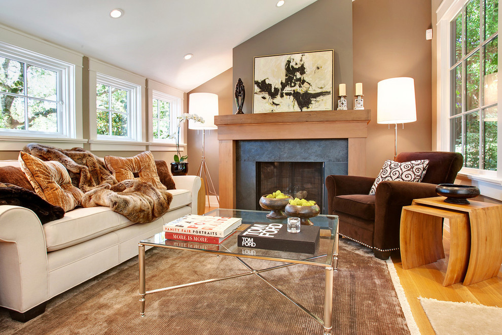 Living room - transitional enclosed living room idea in San Francisco with beige walls and a standard fireplace