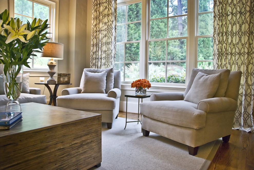 Mid-sized transitional open concept medium tone wood floor and brown floor living room photo in Atlanta with beige walls, a standard fireplace and a stone fireplace
