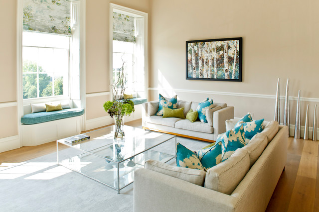 This is an example of a medium sized classic enclosed living room in Other with beige walls and medium hardwood flooring.