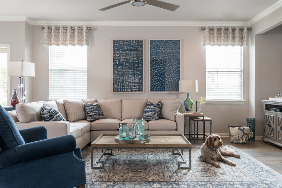 Inspiration for a mid-sized transitional open concept brown floor and medium tone wood floor living room remodel in Dallas with gray walls and a tv stand
