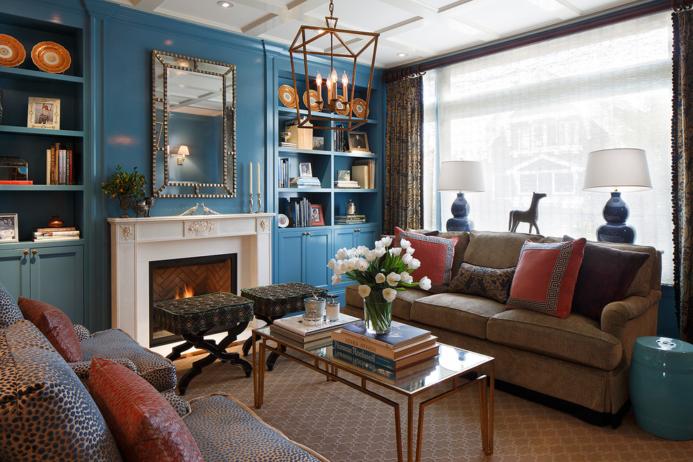Example of a mid-sized transitional formal and enclosed medium tone wood floor living room design in San Francisco with blue walls, a standard fireplace and no tv