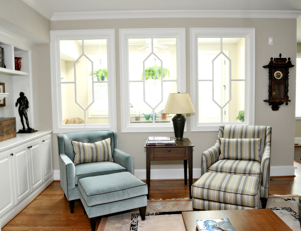 Inspiration for a timeless living room remodel in Raleigh with beige walls