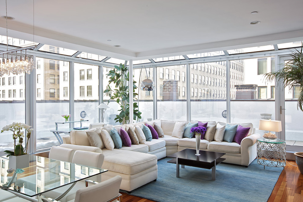 Living room - contemporary medium tone wood floor living room idea in New York