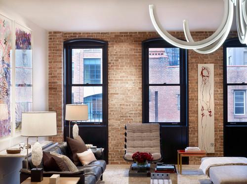 salon à l'ambiance New-Yorkaise avec briques sur le mur