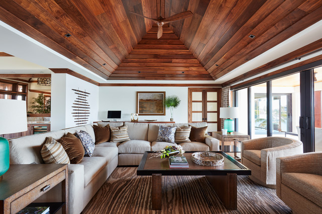 Living room - mid-sized tropical formal and open concept medium tone wood floor and beige floor living room idea in Miami with white walls, no fireplace and no tv
