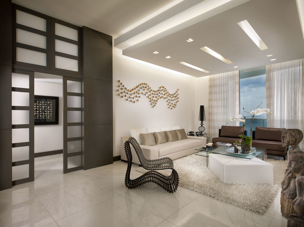 Example of a trendy marble floor living room design in Miami with white walls