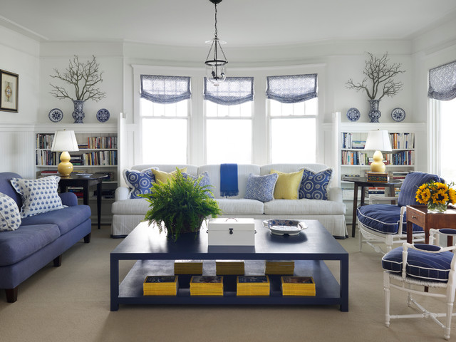 Example of a coastal carpeted living room design in Chicago with white walls
