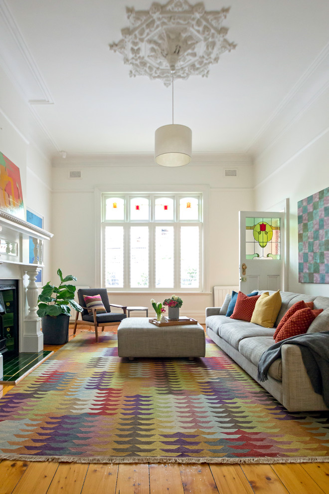 Inspiration for a contemporary formal enclosed living room in Melbourne with white walls, medium hardwood flooring and a standard fireplace.