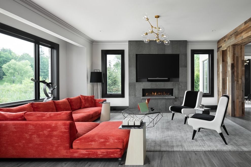 Living room - transitional gray floor living room idea in Detroit with gray walls, a ribbon fireplace, a tile fireplace and a wall-mounted tv