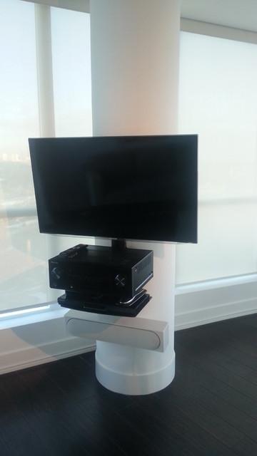 Tv On Concrete Pillar In Condo Modern Living Room