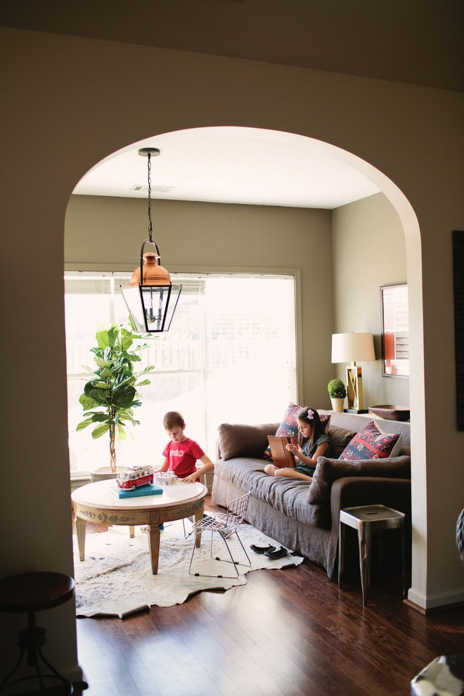 Inspiration for an eclectic enclosed living room remodel in Birmingham with beige walls