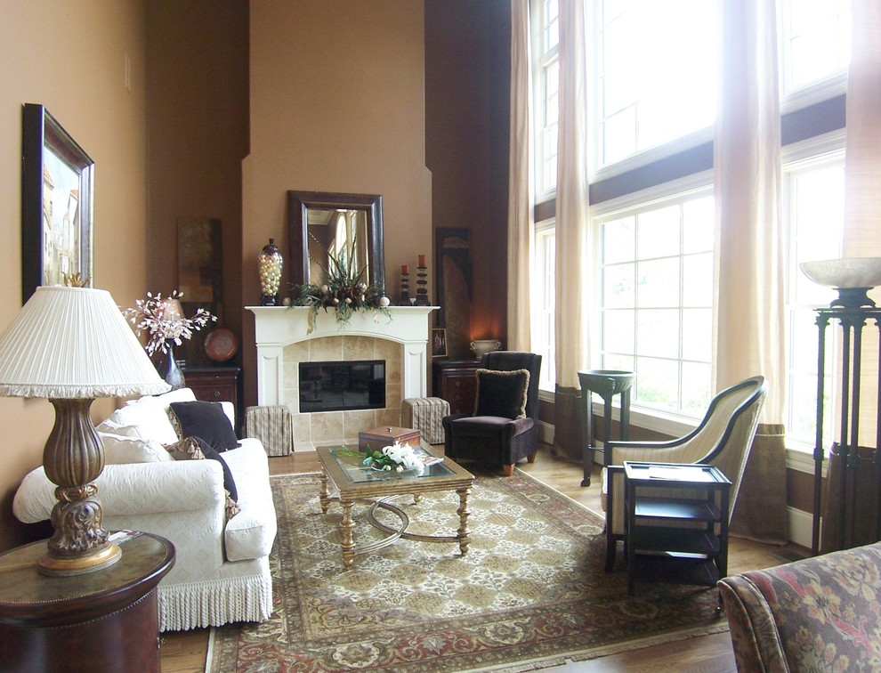 Elegant living room photo in Other with a tile fireplace