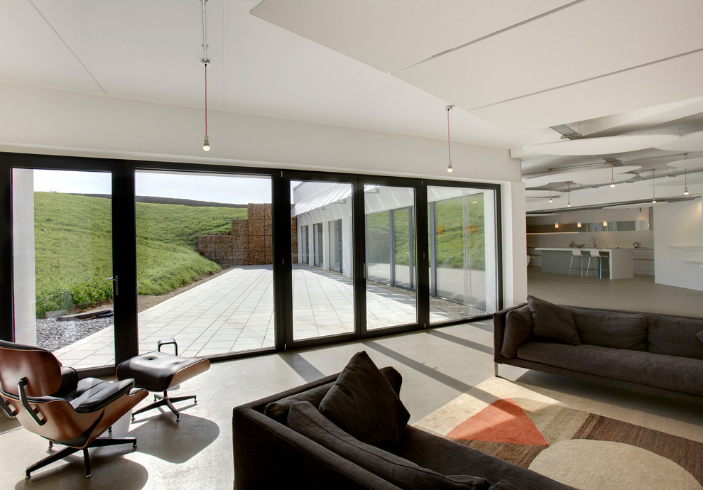This is an example of a contemporary living room in Gloucestershire.